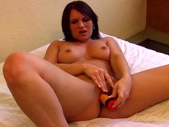 Solo beauty in a double bed fucking a toy videos