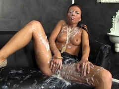 Thick white slime shoots on the girl from a dildo movies at kilogirls.com