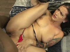 Black balls slap against her ass during an interracial fuck videos