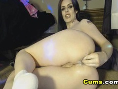 Cam slut shoves a huge dildo up her ass videos