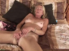 Mature beauty with bikini tan lines masturbates solo movies at freekilomovies.com