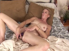 Sexy mature snatch is all wet from a dildo fucking movies at lingerie-mania.com