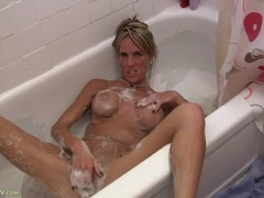 Soapy and sexy milf playing in the bathtub movies at kilogirls.com