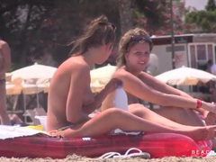 Two topless friends tanning on vacation videos