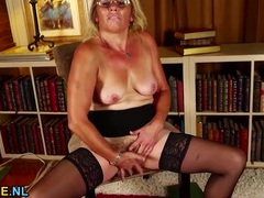 Stripping mature babe in a pair of sexy glasses movies