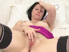 Cute freckled milf masturbates in stockings 2 videos