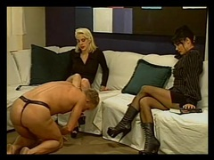 Mistress in a leather skirt dominates the sub guy videos