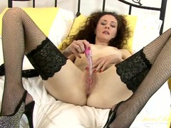 Wet pink cunt of a milf aroused by a toy movies at find-best-mature.com