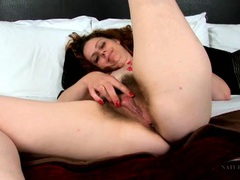 Mom pulling on her pubic hair in close up movies at kilogirls.com