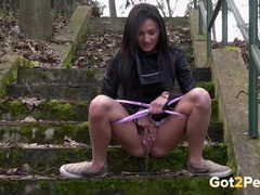 Teen in a tight skirt pissing on a public stairway videos