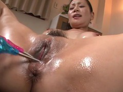 Vibrating toys delight the oiled up japanese chick tubes at japanese.sgirls.net
