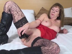 Stockings are hot on this dildo fucking mature babe movies
