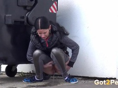 Shiny leggings girl pees behind a dumpster tubes