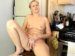 Excited housewife fingers her snatch in the kitchen videos