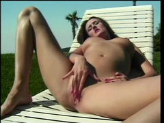 Naked beauty on a lounge chair plays with her cunt videos