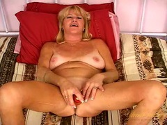 Big orange dildo fucks a shaved mature pussy videos