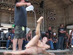 Topless chicks on stage and playing for the crowd tubes