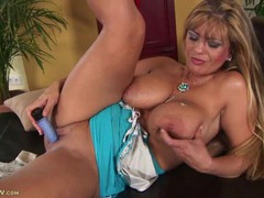 Big natural milf tits are glorious as she plays videos