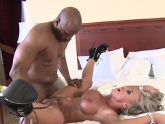 Big black cock busts a nut on her milf titties videos