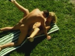 Blonde in the grass spreads wide for great sex movies at sgirls.net