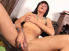 Mature snatch is all wet as she fucks a dildo videos