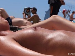 Beach spies film the perky tits of girls in close up tubes