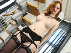 Redhead slips out of her tight corset to tease her tits videos