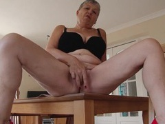 Granny rubs panties all over her pussy movies