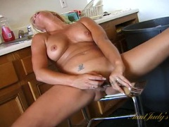 Naked housewife fucks a kitchen utensil into her pussy videos