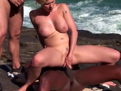 Oceanside interracial threesome on the rocks tubes
