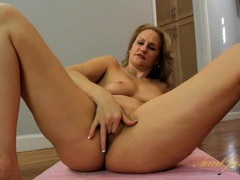 Milf spreads on the yoga mat plays with her pussy videos
