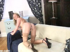 Tan stockings and heels are sexy on the masturbating milf videos
