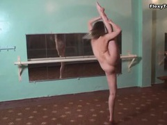 Naked gymnast is wonderfully flexible tubes