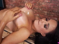 Babe rubs oil on her fake tits to tease movies at freekiloclips.com