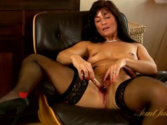 Classy milf looks splendid as she strips for you movies at lingerie-mania.com