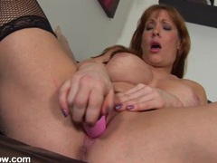 Redhead guides a dildo into her mom pussy videos