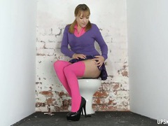 Schoolgirl on the toilet gives an upskirt show videos