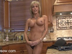 Fit milf in her kitchen showing off her implants videos
