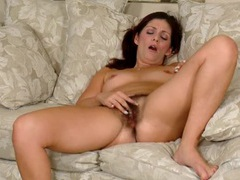 Cute stripping milf has a wonderful hairy bush videos
