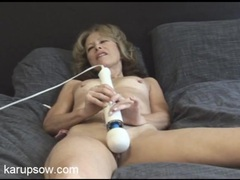Tiny tits mom turns on her toy and gets off tubes