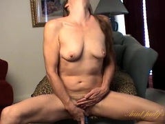 Aroused mom stuffs a blue dildo into her cunt clip