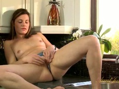 Pretty housewife in panties excites her pussy in the kitchen videos