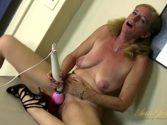 Big red dildo ramming her wet mature pussy videos
