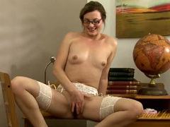 Pretty chick in glasses and stockings rubs her cunt videos