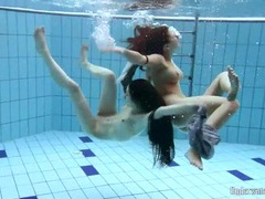 Two skinny chicks swimming naked underwater tubes