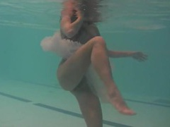 Sheer white dress on a teen swimming in the pool movies at kilomatures.com