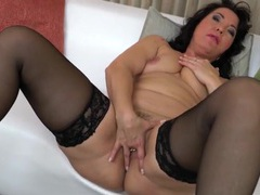 Thick mom shoves a finger deep into her cunt videos