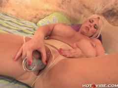 Blonde milf with giant tits takes a dildo up her snatch tubes