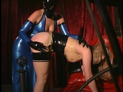 Latex slave spanked and put in a cage videos