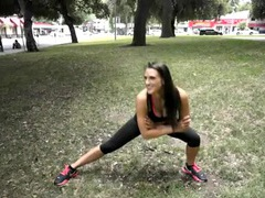Sporty milf in skimpy workout clothes in a public park movies at sgirls.net
